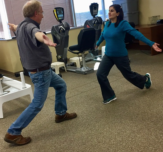 therapist and patient doing lunges